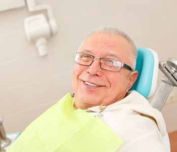 Image of a Adult man sitting on the dentist chair