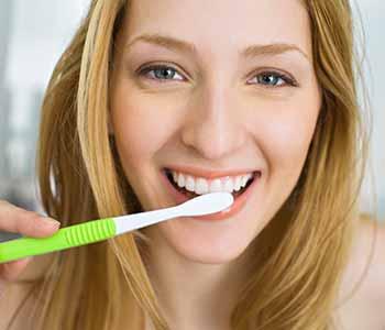 Pretty lady is brushing teeth